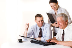 Three businessmen working Stock Images