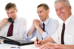 Three businessmen working Stock Photography