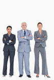 Three businesspeople with arms folded Royalty Free Stock Images