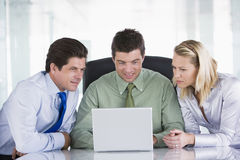 Three businesspeople in a boardroom Royalty Free Stock Image