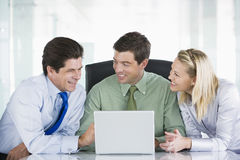 Three businesspeople in a boardroom stock image