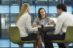 Three Businesspeople During Coffee Break Stock Image