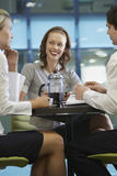Three Businesspeople During Coffee Break Royalty Free Stock Photo