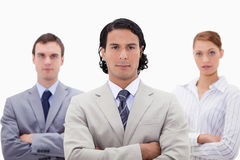 Three businesspeople with folded arms Royalty Free Stock Image