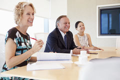 Three Businesspeople Having Meeting In Boardroom Royalty Free Stock Photos