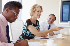 Three Businesspeople Having Meeting In Boardroom Royalty Free Stock Photos