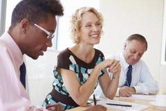 Three Businesspeople Having Meeting In Boardroom Royalty Free Stock Photo