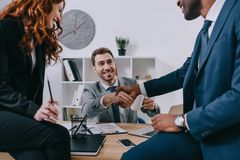 Three businesspeople having meeting royalty free stock images