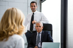 Three businesspeople having a meeting in the office Royalty Free Stock Image