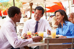 Three Businesspeople Having Meeting In Outdoor Restaurant Royalty Free Stock Photos
