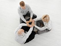 Three businesspeople meditating together Stock Photos