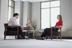 Three Businesspeople In Meeting Royalty Free Stock Photos