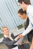 Three businesspeople at office Royalty Free Stock Photo