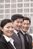 Three businesspeople outdoors Royalty Free Stock Images