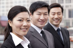 Three businesspeople outdoors Stock Image