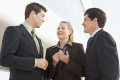 Three businesspeople standing outdoors by building Royalty Free Stock Photos