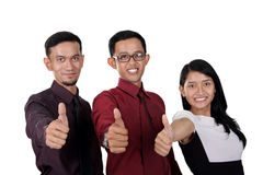 Three businesspeople thumbs up Stock Photo