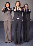 Three businesswoman show thums up gesture Royalty Free Stock Images