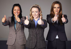 Three businesswoman show thums up gesture Royalty Free Stock Photos