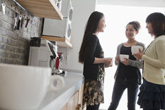Three businesswomen on the coffee break in the office Royalty Free Stock Photos