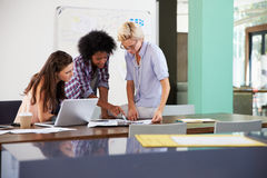 Three Businesswomen Having Creative Meeting In Office Stock Images