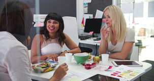 Three Businesswomen Having Working Lunch In Office stock video
