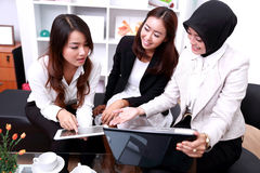 Three businesswomen interacting at meeting Royalty Free Stock Photography