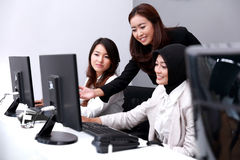 Three businesswomen look happy when they discuss about their wor Royalty Free Stock Image
