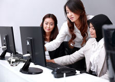 Three businesswomen in a serious meeting at office Royalty Free Stock Images
