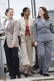 Three businesswomen walking together. Royalty Free Stock Photography