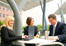 Three Busy Business People Royalty Free Stock Images