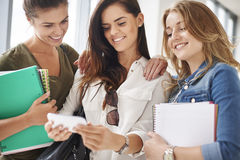 Three busy students on campus Royalty Free Stock Photo