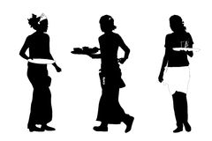 Three busy waitresses Royalty Free Stock Photo