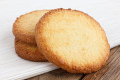 Three butter biscuits on napkin and wood Royalty Free Stock Image