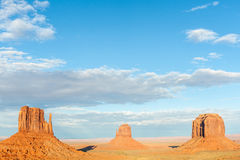 Three buttes in Monument Valley dramatic scenery. Royalty Free Stock Images