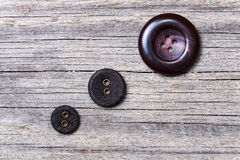 Three buttons. On the background of the old board Royalty Free Stock Photography