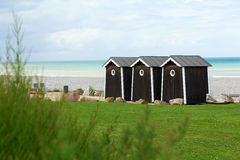 Three cabanas on a beach Royalty Free Stock Photos