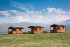 Three cabins against blue sky Royalty Free Stock Images