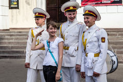 Three cadets with drums  flirt with girl Royalty Free Stock Photos