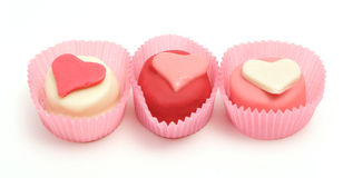 Three cakes. Sweet marzipan cakes with hearts stock photo