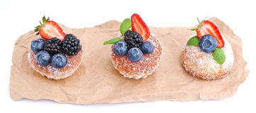Three cakes with blueberry,blackberry and slice of strawberry. Royalty Free Stock Image