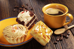 Three cakes and coffee cup Stock Image