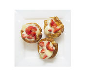 Three cakes with custard and strawberry, isolated Stock Images