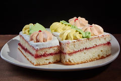 Three cakes on a plate Royalty Free Stock Photos