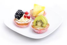 Three cakes on the plate. Isolated. Royalty Free Stock Photo