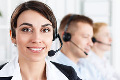 Three call center service operators at work Royalty Free Stock Images