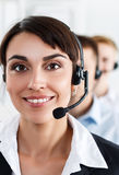 Three call center service operators at work Stock Photos