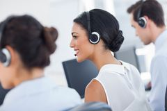 Three call centre employees working Royalty Free Stock Photos