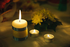 Three small candle of light. Holiday romantic ambience and decor Royalty Free Stock Photos