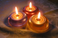 Three candle lights. Three little candle lights on the table Royalty Free Stock Photography